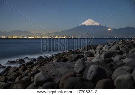 Mountain Fuji with starry night and suruga sea at Hida town Shizuoka prefecture Japan
