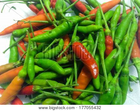Red and green hot spicy chili pepper call Capsicum annuum on white background