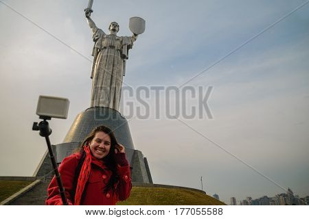 Mother Motherland monument - waman takes selfie in front of statue