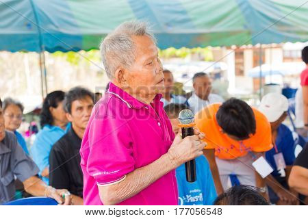 CHIANG RAI THAILAND - FEBRUARY 20 : unidentified man suffering from leprosy with pink shirt speak out at Christian camp on February 20 2016 in Chiang rai Thailand.