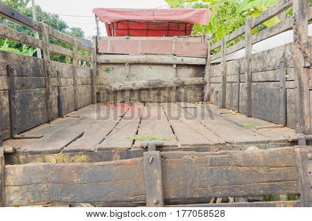 Rear view of a pick up truck made of wood. Perspective view