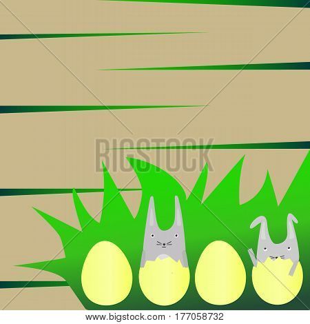 Cute Little Rabbits in Yellow Eggs on the Grass