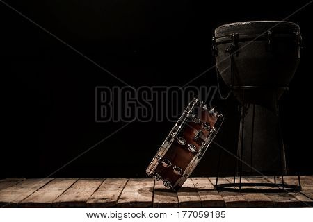 Musical Percussion Instruments On Black Background Drum Bongo And Snare