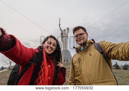 Mother Motherland monument - couple takes selfie in front of statue
