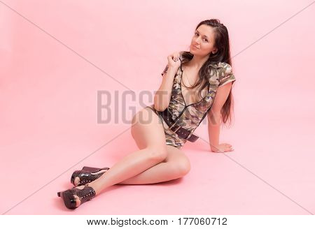 Portrait of a sensual girl on a pink background