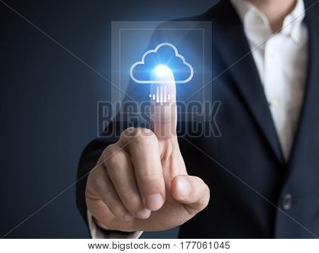 Concept about cloud computing applications storage and services with a businessman touching a button on virtual screen