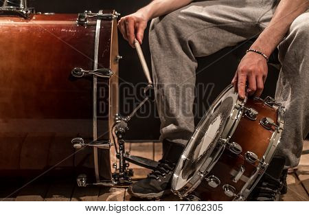 Man Adjusts Percussion Instruments, Creative Music Concept