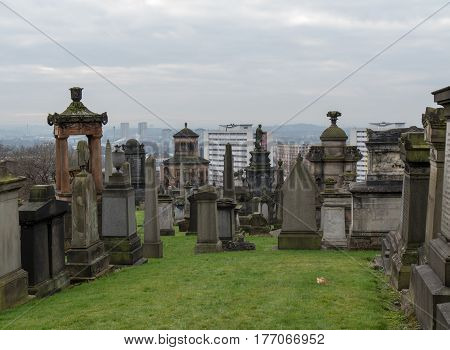 Tombstones on Necropolis, the Victorian cemetery on a hillside in Glasgow.