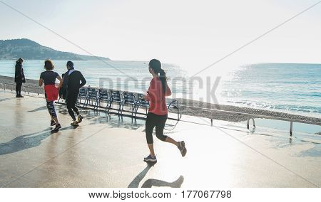 Nice, France - 25 February, People on the embankment go in for sports, 25 February, 2017. People and tourists having a rest on the Cote d'Azur.