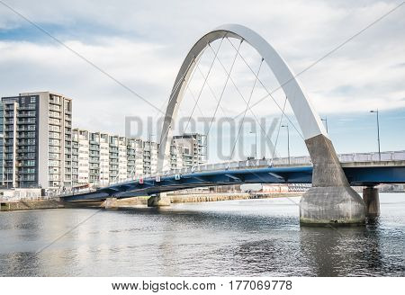 GLASGOW, SCOTLAND - 31 JAN 2017: Clyde Arc bridge, Glasgow, also known as the Squinty Bridge, spans the River Clyde in Glasgow. The bridge, which carries vehicles and pedestrains was opened in 2006