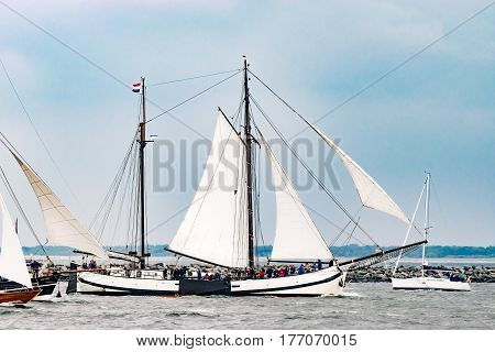Rostock, Germany - August 2016: Sailing ship Carmelan on the baltic sea. Hanse-Sail Warnemuende at port Rostock, Mecklenburg-Vorpommern, Germany. Tall Ship.Yachting and Sailing travel. Cruises and holidays