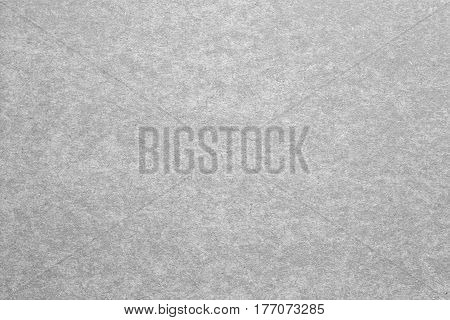 Blank sheet of paper or plywood in grey colours. Rough surface of background. Concept of recycling raw materials. Natural paper background texture for your design. Rustic, vintage style. Horizontal.