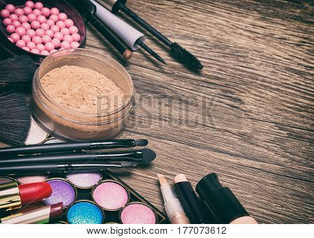 Frame of basic make-up products with copy space, toned image. Make up essentials checklist. Makeup bag must-haves