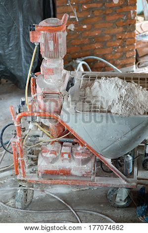 Automatic Spray Plastering Machine for Plastering Walls efficiently on Building of an apartment house