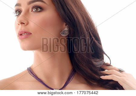 Fashion woman model with long brown hair fresh skin wearing accessories and jewelry isolated over white background