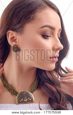 Beautiful woman model with long brown hair fresh skin wearing accessories and jewelry isolated over white background