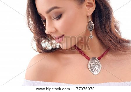 Closeup portrait of beautiful young girl model with long brown hair fresh skin wearing accessories and jewelry isolated over white background