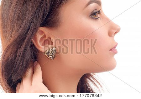 Beautiful girl model showing off her jewellery in fashion concept isolated over white background