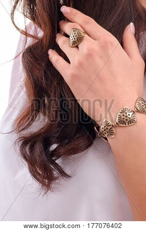 Woman model showing off her jewellery in fashion concept wearing accessories and jewelry isolated over white background