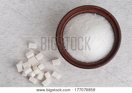 Bowl of white granulated sugar and refined sugar top view