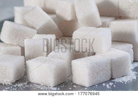 white granulated sugar closeup. Top view on cubes sugar