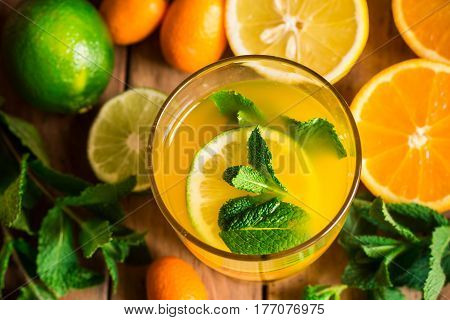 Fresh citrus lemonade from oranges lime fresh mint in glass top view vibrant colors spring detox refreshing beverage