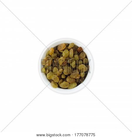 Raisins in a wooden bowl. Dried fruit with copy space for text. Top view. Raisins isolated on white background