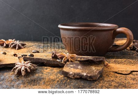 Chocolate, coffee beans, tubby. Spices, cacao on a grunge theme background. Mystical light