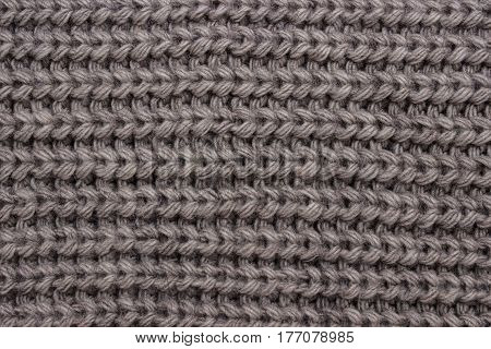 The texture of a knitted scarf with a large viscous
