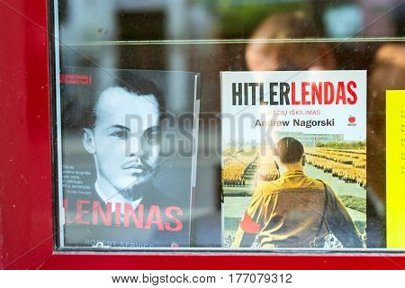 Vilnius Lithuania - August 8 2012: Two history books about Lenin and Hitler standing next to each other on window of bookstore. Struggle ideologies of Bolshevik communism & German national socialism