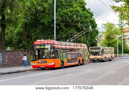 Vilnius Trolley Rides Along A Busy Street