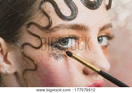 Pretty Girl Putting Holiday Glitter Eyeshadow Makeup