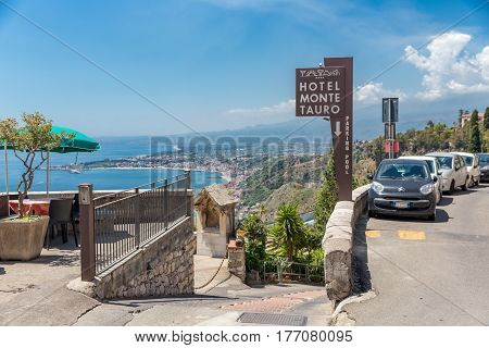 TAORMINA ITALY - MAY 17 2016: Entrance to a four star hotel in Taormina with a beautiful view at the Sicilian coast with the Etna