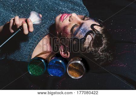 Pretty Fashion Girl Putting Holiday Glitter Powder Makeup