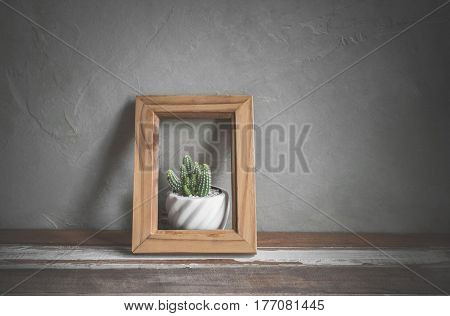 Photo Frame With Cactus Flower On Wood Table Nature Conservation Concept.