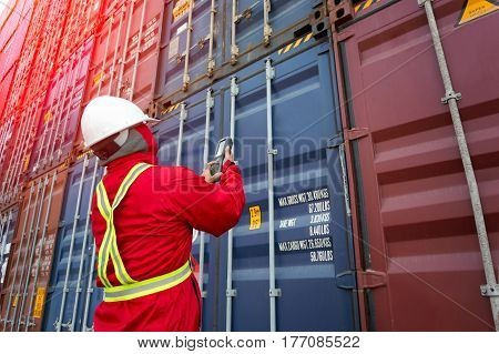 Foreman control loading Containers box from Cargo freight shipFreight shipping containers at the docksLarge container shipping at shipping yard main transportation of cargo container shipping.