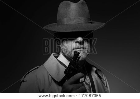 Detective Holding A Gun In The Dark