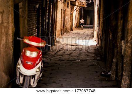 Child Running Through An Alley