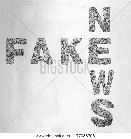 Words fake news made from  newspaper confetti