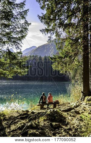 sitting together watching the Alpine Lake scenery