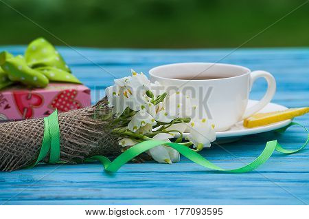 Spring Breakfast Hot Tea And A Bouquet Of Snowdrops