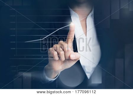 Business woman touching graph at futuristic screen