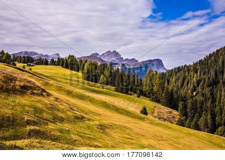 The international ski resort in the fall. Jagged rocks around the Dolomites mountain valley. Concept of active and ecological tourism