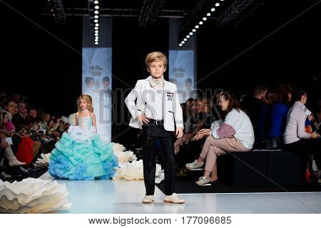 MOSCOW RUSSIA - MARCH 12 2017: Model walk runway for KIBOVSKAYA&PABLOSKY catwalk at Fall-Winter 2017-2018 at Mercedes-Benz Fashion Week Russia. Kid's fashion.