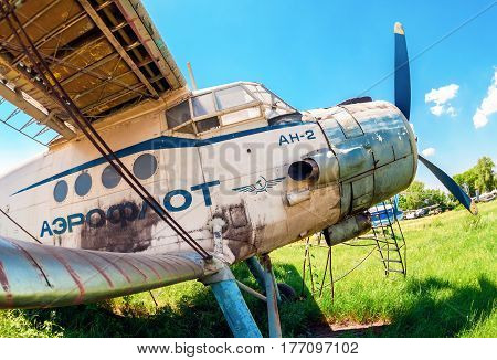 SAMARA RUSSIA - MAY 25 2014: Old russian aircraft An-2 at an abandoned aerodrome in summertime. The Antonov An-2 is a Soviet mass-produced single-engine biplane