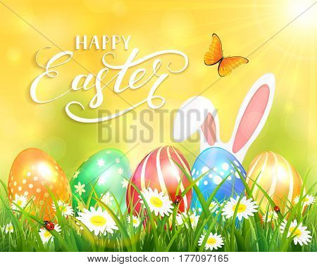 Easter theme with ears of bunny and butterflies flying above the colorful eggs in grass and flowers, yellow nature background with sun beams and lettering Happy Easter, illustration.