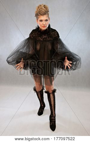 Woman in a black outfit , fashion