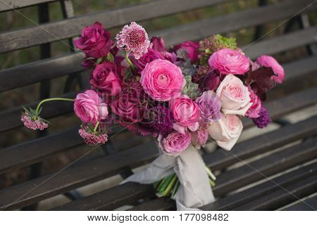 Beautiful wedding bouquet. Pink roses and other flowers.