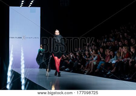 MOSCOW RUSSIA - MARCH 12 2017: Model walk runway for CHAPURIN for FINN FLARE catwalk at Fall-Winter 2017-2018 at Mercedes-Benz Fashion Week Russia.
