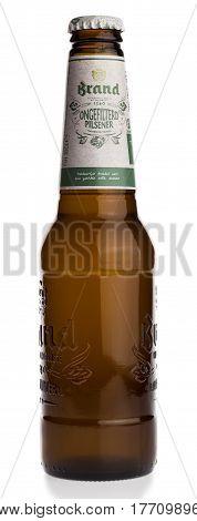 GRONINGEN, NETHERLANDS - MARCH 19, 2017: Bottle of Dutch Brand Ongefilterd Pilsener beer isolated on a white background